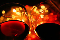 two wine glasses over backlighted background